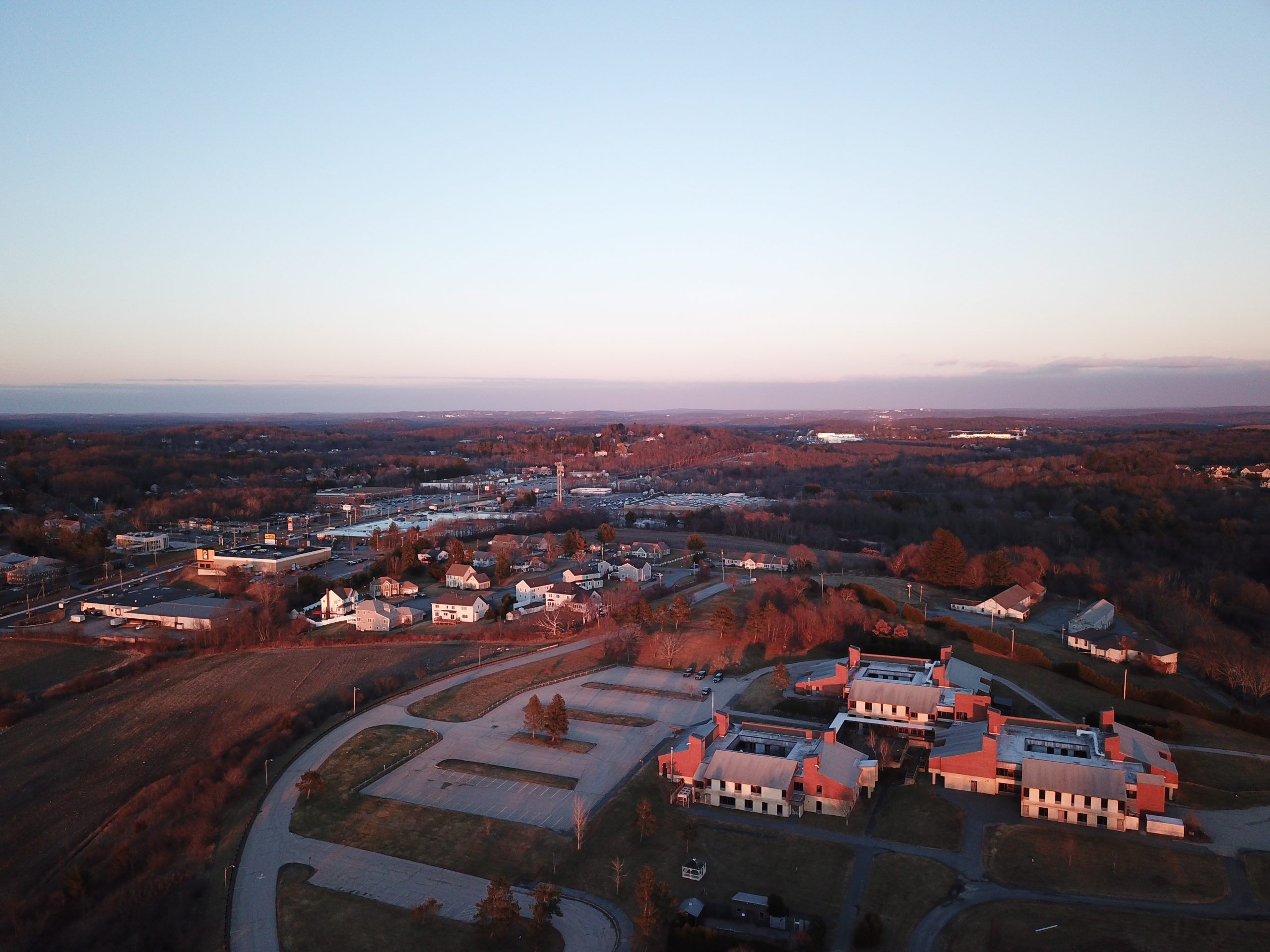 shrewsbury aerial photo of commercial real estate at sunset